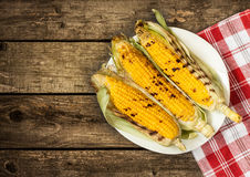 Grilled corn cobs on vintage wood background Royalty Free Stock Image