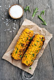 Grilled corn cobs on wooden background Stock Photo