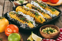 Grilled corn covered in foil Stock Photos