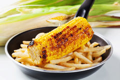Grilled corn with French fries Stock Images