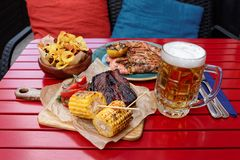 Free Grilled Corn, Hot Bbq Ribs With Mug Of Lager Beer Royalty Free Stock Image - 126320196