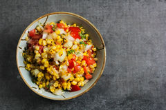 Grilled corn salsa Top view on a dark background. Homemade Grilled corn salsa overhead view stock images