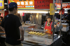 Grilled corn stalls in taipei night market Stock Photo