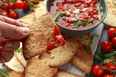 Grilled corn tortilla with sea salt flakes, spicy tomato salsa sauce and feta cheese.  stock image