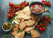 Grilled corn tortilla with sea salt flakes, spicy tomato salsa sauce and feta cheese.  royalty free stock photography