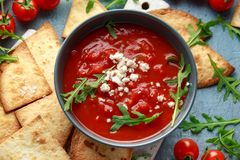 Grilled corn tortilla with sea salt flakes, spicy tomato salsa sauce and feta cheese.  stock photos