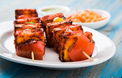Grilled cottage cheese or also known as Paneer Tikka Kebab or chili paneer or chilli paneer or tandoori paneer in india India, bar Royalty Free Stock Photos