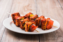 Grilled cottage cheese or also known as Paneer Tikka Kebab or chili paneer or chilli paneer or tandoori paneer in india India, bar Royalty Free Stock Photography