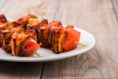 Grilled cottage cheese or also known as Paneer Tikka Kebab or chili paneer or chilli paneer or tandoori paneer in india India, bar Stock Photos