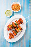 Grilled cottage cheese or also known as Paneer Tikka Kebab or chili paneer or chilli paneer or tandoori paneer in india India, bar. Becued in red sauce Royalty Free Stock Images