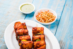 Grilled cottage cheese or also known as Paneer Tikka Kebab or chili paneer or chilli paneer or tandoori paneer in india India, bar Stock Images