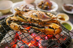 Grilled crab on a flaming grill. Thailand street food royalty free stock images