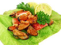 Grilled crab meat, mussels and shrimps Stock Images
