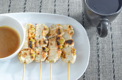 Grilled cultivated banana. In dish with glass on a placemat Stock Photos