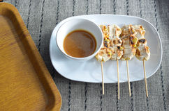 Grilled cultivated banana. In dish with wooden tray on a placemat Stock Photography