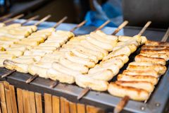 Grilled cultivated banana skewers Thai dessert. Banana stock photo