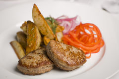 Grilled Cutlet And French Fries Stock Images