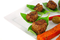 Grilled cutlets on basil leafs Stock Images