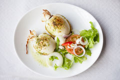 Grilled cuttlefish with salad. Fresh grilled cuttlefish served with salad in local restaurant in Garachico on tropical island Tenerife, Canary in Spain. Spanish Royalty Free Stock Image