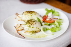 Grilled cuttlefish with salad. Fresh grilled cuttlefish served with salad in local restaurant in Garachico on tropical island Tenerife, Canary in Spain. Spanish Royalty Free Stock Images