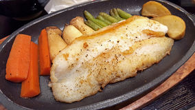 Grilled dolly fish in hot pan Stock Photo