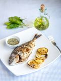 Grilled dorada fish with lemon and spinach Royalty Free Stock Images