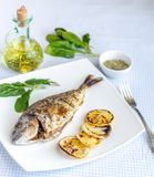 Grilled dorada fish with lemon and spinach Stock Photo