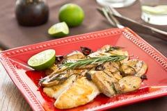 Grilled Dory fish with sautéed mushroom Stock Photos