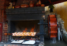 Grilled dressed chickens in the fireplace Stock Photo