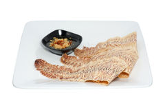 Grilled  dried  squid. With sweet and sour sauce isolated on white Stock Images
