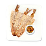 Grilled dried squid. With sweet and sour sauce isolated on white Royalty Free Stock Photography