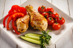Grilled drumsticks Stock Photo