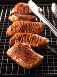 Grilled duck breast. Fillet of grilled duck breast on a lack. Preparing for making a steak dish Royalty Free Stock Photography