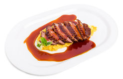 Grilled duck breast on mango puree. Stock Photography