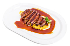 Grilled duck breast on mango puree. Royalty Free Stock Photos