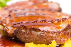 Grilled duck breast on mango puree. Royalty Free Stock Photography