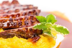 Grilled duck breast on mango puree. Stock Photos