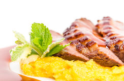 Grilled duck breast on mango puree. Royalty Free Stock Image