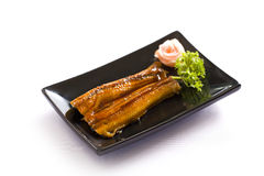 Grilled eels unagi on white Stock Photos