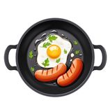 Grilled egg and sausage at frying pan Stock Images