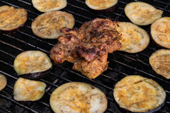 Grilled eggplant and chicken steak on grill grid fire Royalty Free Stock Photo