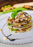 Grilled eggplant with feta cheese,parmesan basil, nuts Stock Images