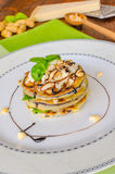 Grilled eggplant with feta cheese,parmesan basil, nuts Royalty Free Stock Photo
