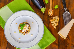 Grilled eggplant with feta cheese,parmesan basil, nuts Royalty Free Stock Photography