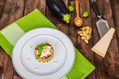 Grilled eggplant with feta cheese,parmesan basil, nuts Royalty Free Stock Photos