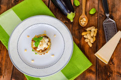Grilled eggplant with feta cheese,parmesan basil, nuts Royalty Free Stock Image