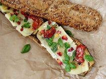 Grilled eggplant sandwich. Mediteranean sandwich with grilled eggplant,basil,sundried tomatoes Stock Photography