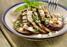 Grilled eggplant slices on a plate Stock Image