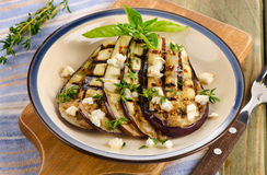 Grilled eggplant slices on a plate Royalty Free Stock Photography