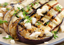 Grilled eggplant slices on a plate. Stock Images